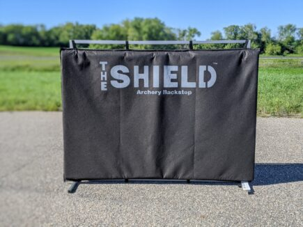 Stand with archery backstop attached